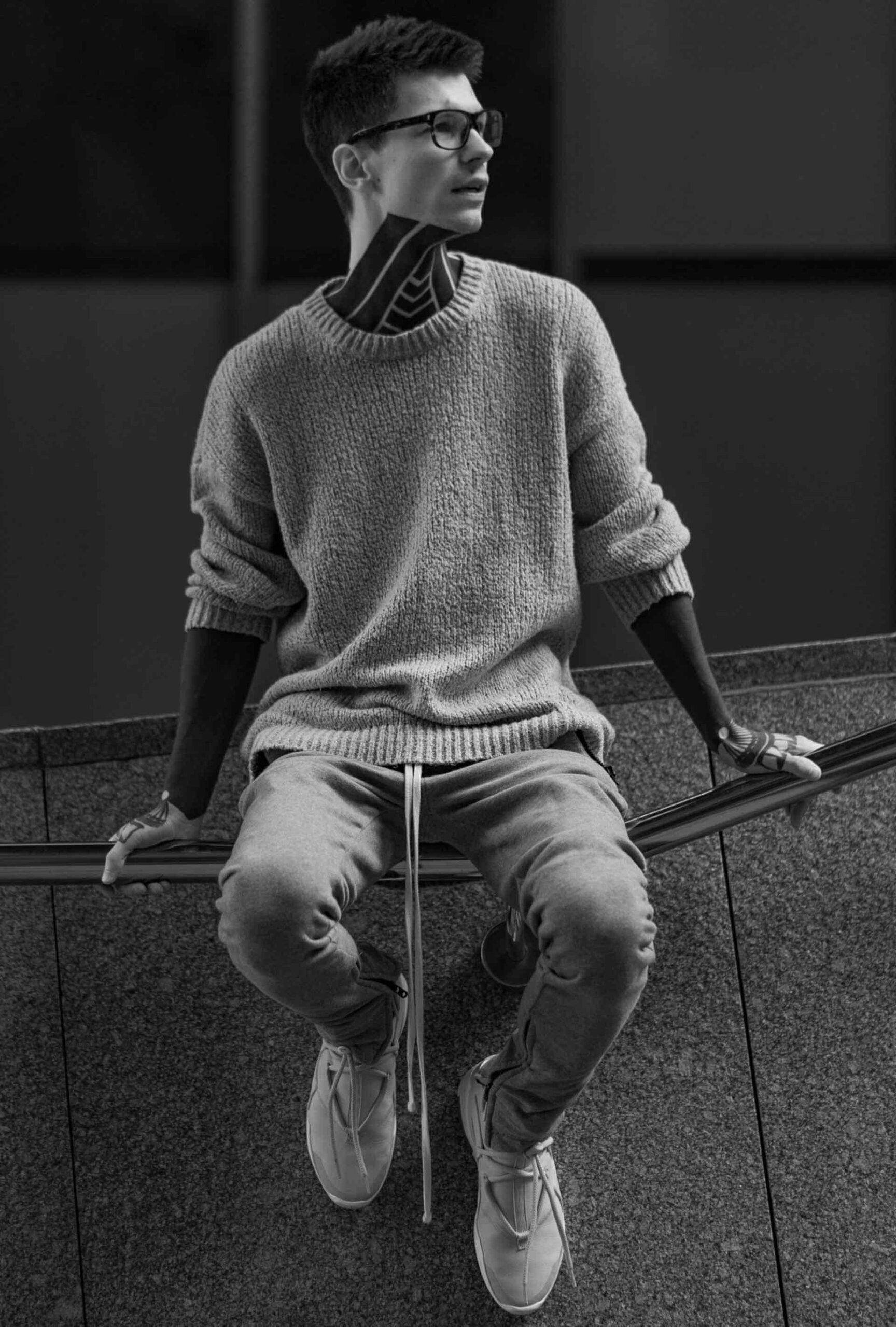 a man sitting on a wall